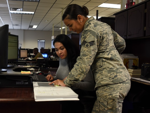 Airman and civilian working together