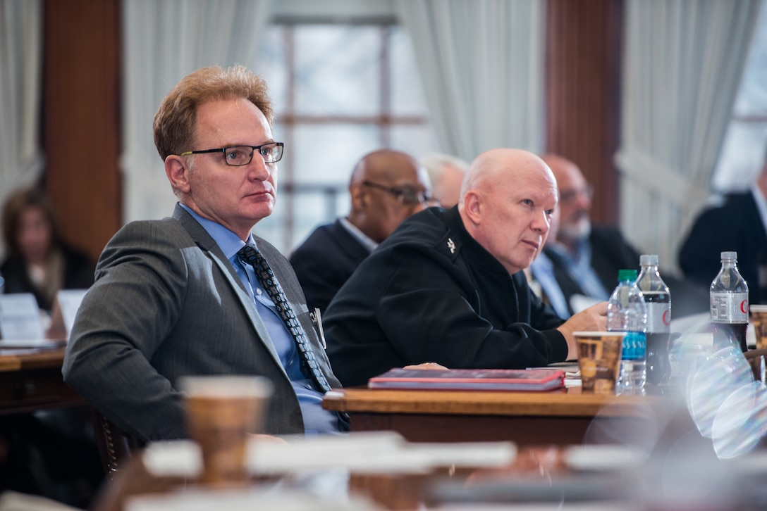 """Thomas B. Modly, undersecretary of the Navy, and Rear Adm. Jeffrey A. Harley, Naval War College president, listen to a presenter at the """"Breaking the Mold; A Workshop on War and Strategy in the 21st Century,"""" held in Newport, R.I."""