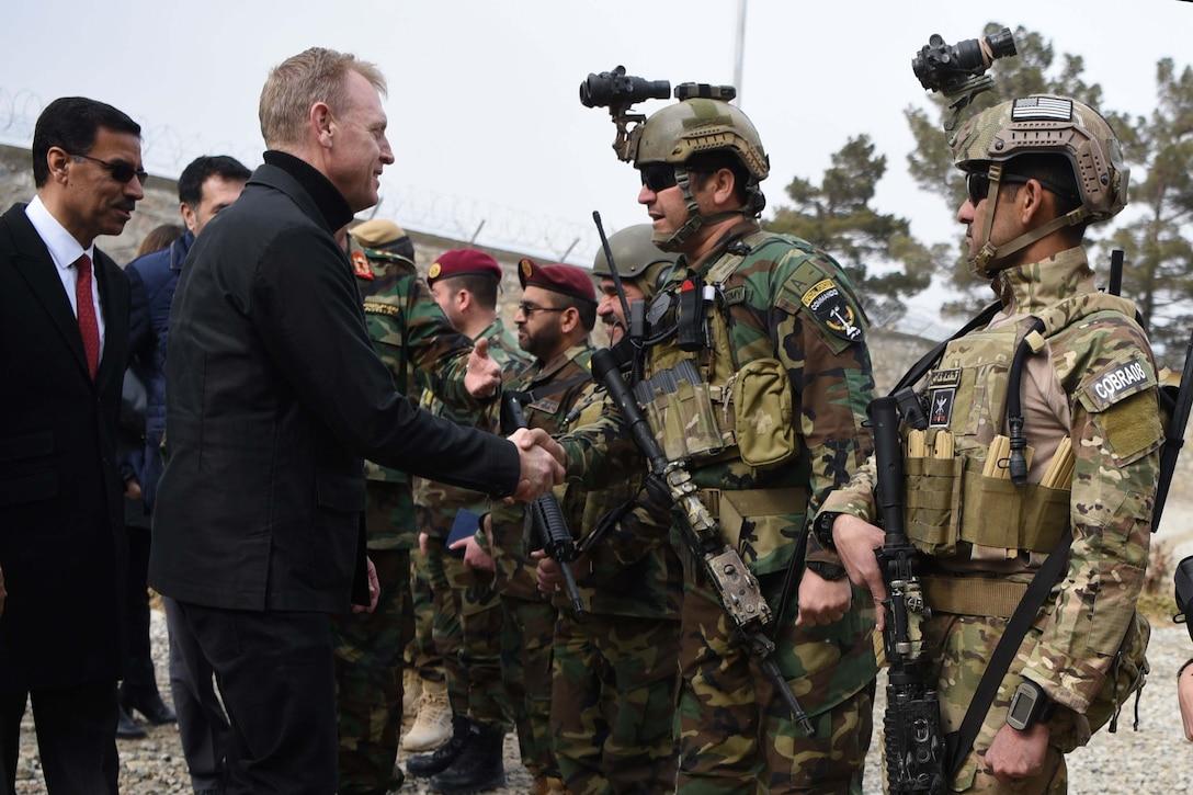 Acting Defense Secretary Patrick M. Shanahan shakes hands with Afghan commandos at Camp Commando, Afghanistan.