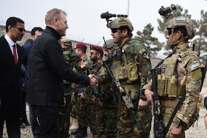 Acting Defense Secretary Patrick M. Shanahan shakes hands with Afghan commandos at Camp Commando, Afghanistan.