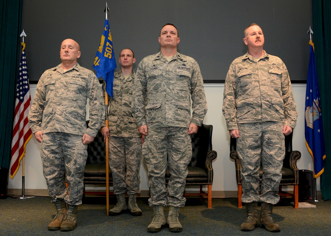 Lt. Col. William Young, center, stands before the 72nd Aerial Port Squadron prior to relinquishing command Feb. 10, 2019, at Tinker Air Force Base, Oklahoma. Col. Richard Ropac, left, 507th Mission Support Group commander, transferred the guidon to new commander, Lt. Col. Darryl McLean, moments later. (U.S. Air Force photo by Tech. Sgt. Samantha Mathison)