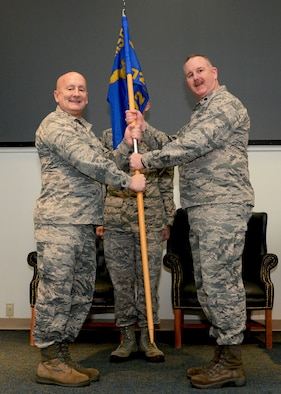 Col. Richard Ropac, 507th Mission Support Group commander, hands the 72nd Aerial Port Squadron guidon Lt. Col. Darryl McLean, Feb. 10, 2019, during a change of command ceremony at Tinker Air Force Base, Oklahoma. (U.S. Air Force photo by Tech. Sgt. Samantha Mathison)