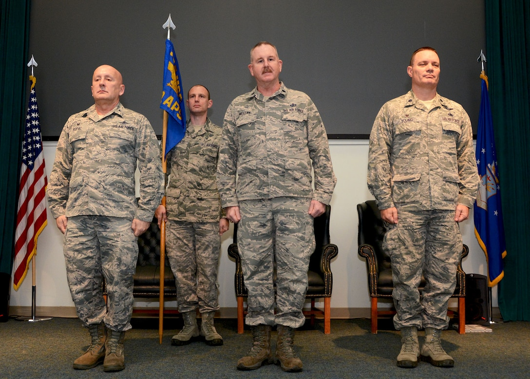 Lt. Col. Darryl McLean, center, stands before the 72nd Aerial Port Squadron after being named their new commander Feb. 10, 2019, Tinker Air Force Base, Oklahoma. Col. Richard Ropac, left, 507th Mission Support Group commander, transferred the guidon to McLean from Lt. Col. William Young, right, after Young served as 72nd APS for nine years. (U.S. Air Force photo by Tech. Sgt. Samantha Mathison)