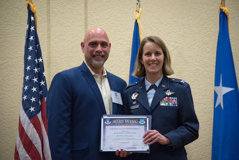 Col. Jennie Johnson, 403rd Wing commander poses with Mr. Michael Pocchiari, Garden Park Medical Center Vice President of Human Resources HCA during his induction into the Honorary Commanders program during a ceremony at Keesler Air Force Base, Mississippi February 9, 2019.  The Honorary Commanders program was developed to enhance relationships between the local civilian community and the 403rd wing. (U.S. Air Force photo by Staff Sgt. Shelton Sherrill)