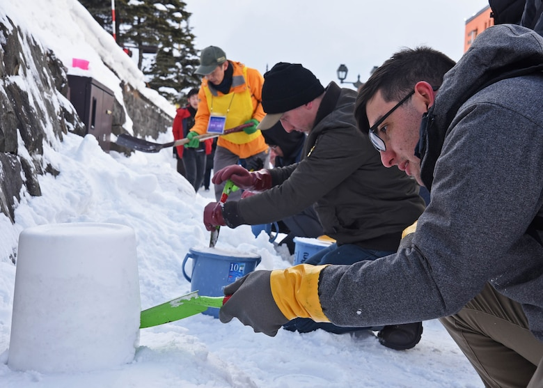Yeoman 3rd Class Thomas Lattanzio, from Nyack, N.Y., builds a snow lantern during a community relations event in support of the Snow Light Path Festival in Otaru, Japan.