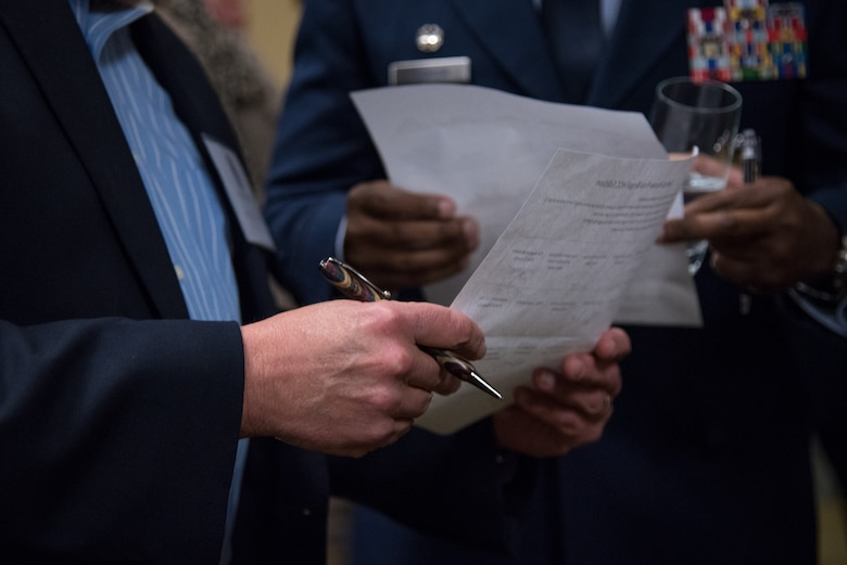 Attendees of the Honorary Commanders Induction Ceremony participate in an icebreaker at Keesler Air Force Base, Mississippi February 9, 2019.  The Honorary Commanders program was developed to enhance relationships between the local civilian community and the 403rd wing. (U.S. Air Force photo by Staff Sgt. Shelton Sherrill)