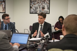 Defense Department Chief Information Officer Dana Deasy speaks during a roundtable meeting.