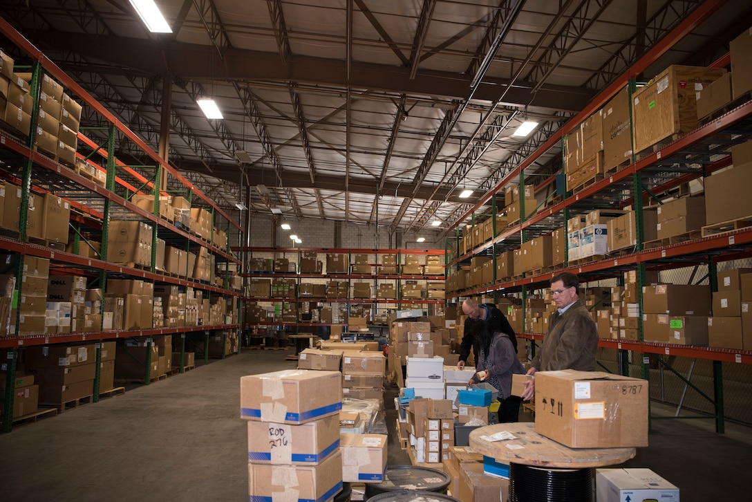 Three 30th Contracting Squadron civilians survey items in a warehouse used for storing government furnished property Feb. 12, 2018, on Vandenberg Air Force Base, Calif. The team is responisble for saving $1 billion over the course of seven years.