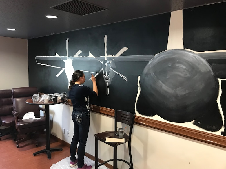 1st Lieutenant Jayna Dodd, 374th OSS chief of Intelligence, Surveillance and Reconnaissance, paints a C-130J Super Hercules at the Operations Support Squadron heritage room at Yokota Air Base, Japan, Nov. 4, 2018.