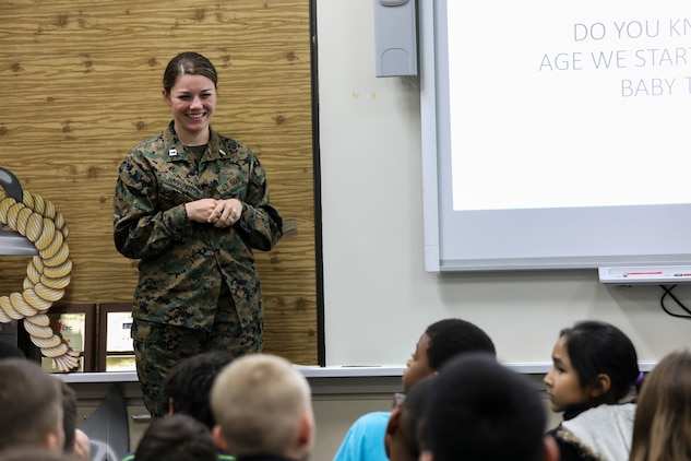 Navy Lt. Kathryn Harrington gives a presentation to students from Kinser Elementary School on oral health Feb. 5, 2019 on Camp Kinser, Okinawa, Japan. Sailors from Naval clinics in Okinawa, held a presentation to promote oral health awareness during National Children's Dental Health Month. Harrington, a general dentist with Branch Dental Clinic Futenma, 3rd Dental Battalion, 3rd Marine Logistics Group, is a native of Cleveland, Ohio. (U.S. Marine Corps photo by Armando Elizalde)