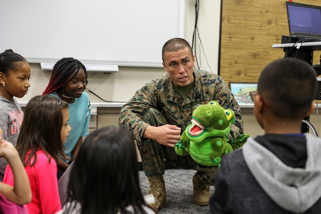 Petty Officer 2nd Class Mark D. Abundo speaks to students about the importance of oral health Feb. 5, 2019 on Camp Kinser, Okinawa, Japan. Sailors from Naval clinics in Okinawa held a presentation to promote oral health awareness during National Children's Dental Health Month. Abundo, a hospital corpsman with Branch Dental Clinic Kinser, 3rd Dental Battalion, 3rd Marine Logistics Group, is a native of Camarillo, California. (U.S. Marine Corps photo by Armando Elizalde)