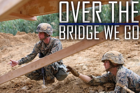 Cpl. William Vincent, left, and Lance Cpl. Bryce Taft inspect damage on a bridge structure Feb. 7, 2019 at Camp Hansen, Okinawa, Japan. Marines with Medium Girder Bridge Platoon, Bridge Company, 9th Engineer Support Battalion, 3rd Marine Logistics Group, repaired then disassembled a bridge they constructed earlier that week to further train in bridge building. Vincent, a combat engineer team leader with MGB Plt., Bridge Co., 9th ESB, 3rd MLG, is a native of Springfield, Illinois. Taft, a combat engineer fire team leader with MGB Plt., Bridge Co., 9th ESB, 3rd MLG, is a native of Maricopa, Arizona. (U.S. Marine Corps photo by Lance Cpl. Ryan Harvey)