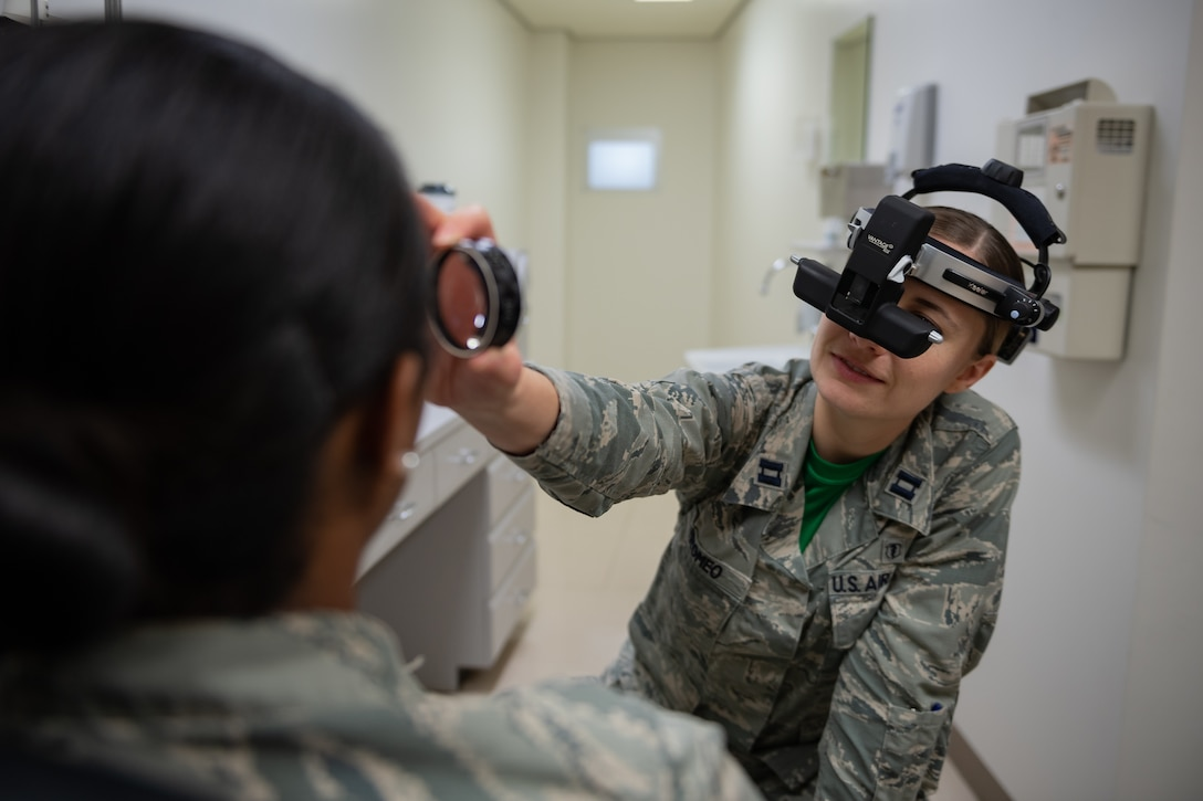 U.S. Air Force Capt. Suzanne Romeo, 18th Medical Group operational optometry chief, conducts a vision test Jan. 11, 2019, at Kadena Air Base, Japan. These practitioners do everything from prescribing correctional lenses to diagnosing conditions related to the ocular system. (U.S. Air Force photo by Staff Sgt. Micaiah Anthony)