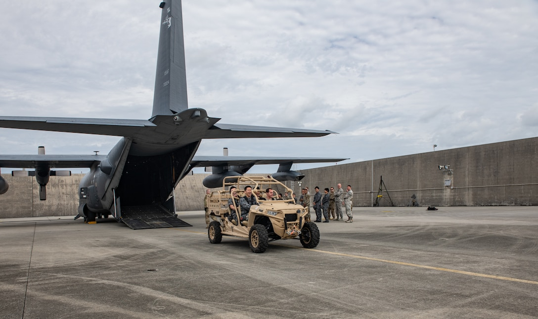Japan Air Self-Defense Force Airmen and U.S. service members take part in an MC-130H Combat Talon II infiltration and exfiltration demonstration Nov. 19, 2018, during the 2018 Bilateral Exchange at Kadena Air Base, Japan. The event included professional enhancement seminars, physical training, a historical tour and team building exercises. (U.S. Air Force photo by Staff Sgt. Micaiah Anthony)