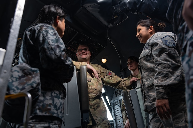 U.S. Air Force Master Sgt. Michael Gillette, 1st Special Operations Squadron superintendent, gives a briefing about the MC-130H Combat Talon II to Japan Air Self-Defense Force Airmen and U.S. service members Nov. 26, 2018, during the 2018 Bilateral Exchange at Kadena Air Base, Japan. The exchange lasted 10 days and enabled 30 U.S. service members and JASDF Airmen to strengthen teamwork, develop communication skills and build camaraderie. (U.S. Air Force photo by Staff Sgt. Micaiah Anthony)