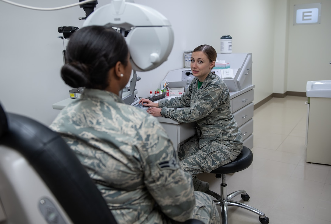 U.S. Air Force Capt. Suzanne Romeo, 18th Aerospace Medicine Squadron operational optometry chief, conducts a vision test on Airman 1st Class Praise Butler-Davis, 18th AMDS optometry technician, Jan. 11, 2019, at Kadena Air Base, Japan. These practitioners do everything from prescribing correctional lenses to diagnosing conditions related to the ocular system. (U.S. Air Force photo by Staff Sgt. Micaiah Anthony)