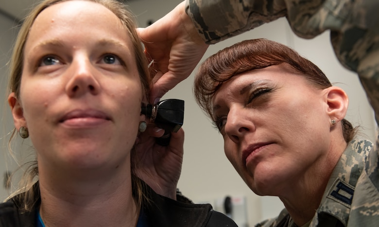 U.S. Air Force Capt. Andrea Tidd, 18th Medical Services Flight commander and physician assistant, examines the ear of Deana Ladd, 18th Medical Group registered nurse, Jan. 23, 2019, at Kadena Air Base, Japan. Physician assistants often serve as a patient's principal healthcare provider. Their role in patient care consists of diagnosing illnesses, developing and managing treatment plans and prescribing medications. (U.S. Air Force photo by Staff Sgt. Micaiah Anthony)