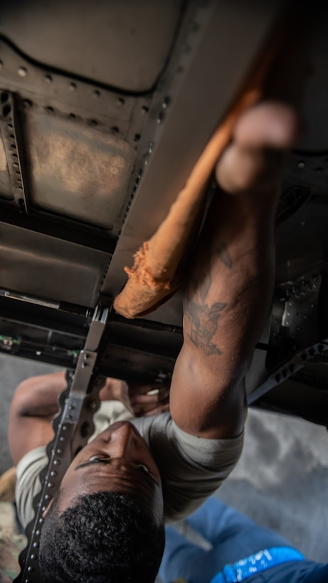 U.S. Air Force Airman 1st Class Nathaniel West, 18th Aircraft Maintenance Squadron crew chief, cleans an F-15 Eagle engine bay compartment, Jan. 18, 2019, on Kadena Air Base, Japan. Airmen from the 18th AMXS cleaned the engine bay to help them identify and repair cracks and gouges. (U.S. Air Force photo by Staff Sgt. Micaiah Anthony)