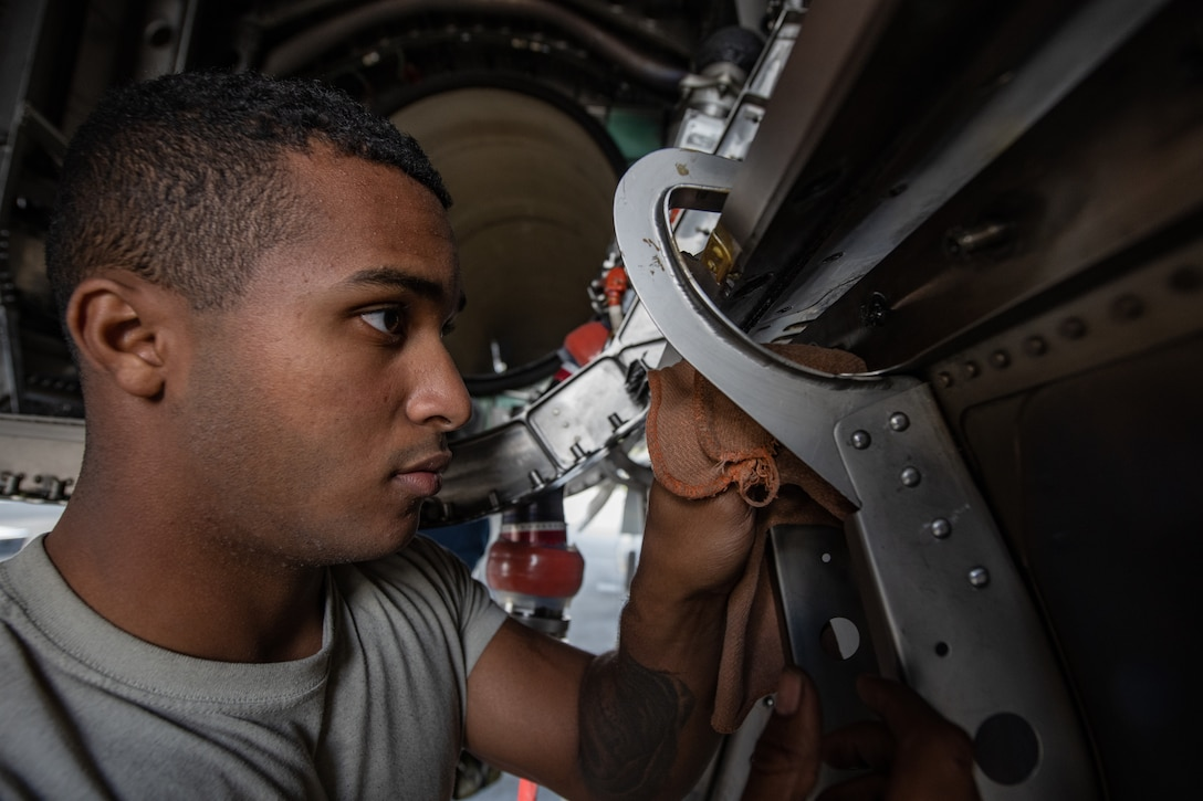 U.S. Air Force Airman 1st Class Nathaniel West, 18th Aircraft Maintenance Squadron crew chief, cleans an F-15 Eagle engine bay compartment, Jan. 18, 2019, on Kadena Air Base, Japan. The F-15 Eagle is powered by two turbofan engines that are capable of producing 23,450 pounds of thrust per engine.  (U.S. Air Force photo by Staff Sgt. Micaiah Anthony)