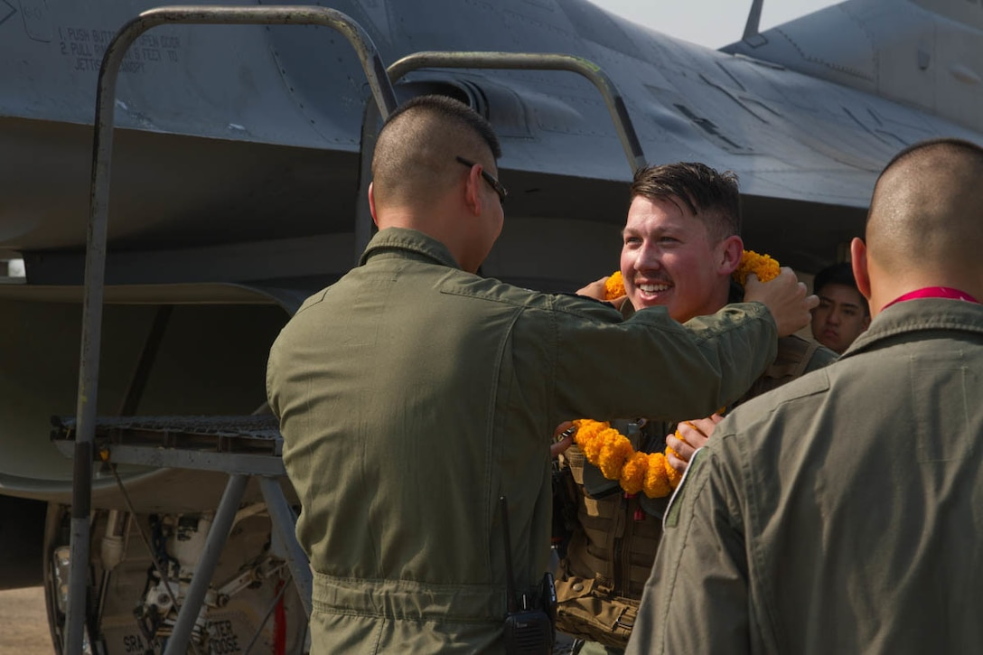 U.S. Air Force 1st Lt. Cameron Fierro, 35th Fighter Squadron pilot, greets Royal Thai Air Force squadron leader Suppawath Boonarch for Exercise Cobra Gold 2019 at Korat Royal Thai Air Force Base, Thailand, Feb. 6 2019.