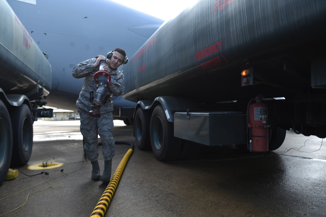U.S. Air Force Airman 1st Class Gabriel Praslin-Trewin, 39th Logistics Readiness Squadron fuels specialist, returns the fuel hose after filling up an aircraft at Incirlik Air Base, Turkey, Feb. 1, 2019.