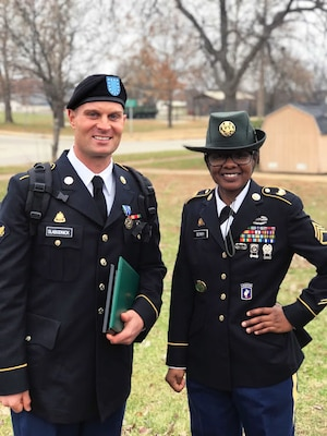 Ohio Army National Guard Spec. Adam Slabodnick stands with his drill sergeant after completing advanced individual training in December 2018 at Fort Leonard Wood, Mo., to become a transportation operator. Slabodnick, a health and physical education teacher in northern Ohio, joined the National Guard at the age of 35 and will drill with the 1485th Transportation Company in Dover, Ohio.