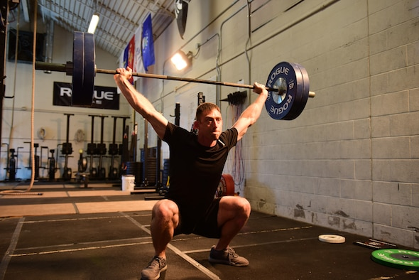 U.S. Air Force Tech. Sgt. Brandon, a member of the 118th Wing, Tennessee Air National Guard, performs an overhead squat during a high-intensity workout Feb. 9, 2019, at Berry Field Air National Guard Base, Nashville, Tennessee. An owner of two gyms and a meal preparation company, Brandon credits his military service with enabling him to find his physical fitness talents.