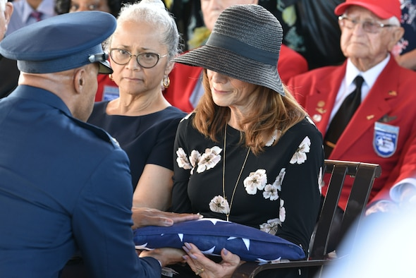 Col. Kevin Williams, 45th Mission Support Group commander, hands the flag to Shelley Cowan Arnold, daughter of Edwin Cowan, Tuskegee Airman, during a funeral, Feb. 7, 2019 at Cape Canaveral National Cemetery in Mims, Fla. Edwin Cowan was buried with full military honors and was buried alongside his wife Theda. (U.S. Air Force photo by Airman 1st Class Dalton Williams)