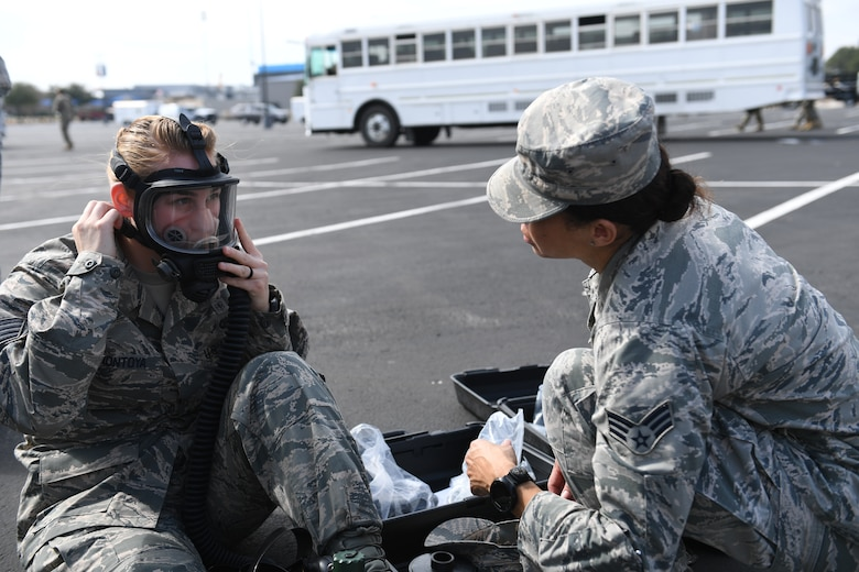 Staff Sgt. Jacquelyn Montoya and Senior Airman Kimberly Gaona, members of the 149th Fighter Wing's MDG Det-1, which is part of the 6th CERFP task force, perform an operations check prior to deploying into the disaster incident site during response training Feb. 5 in Round Rock, Texas.