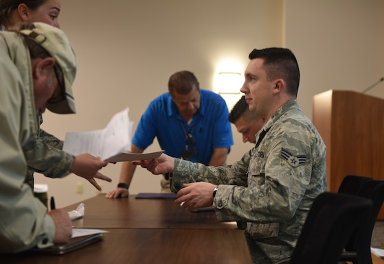 Airman handing customer paperwork