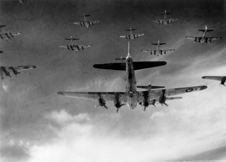 A formation of B-17 Flying Fortress aircraft on the way to bomb industrial targets in Germany, early 1944. Starting in late 1942 through October 1943, B-17s, along with B-24 Liberator strategic bombers conducted unescorted daylight precision bombing raids on German industrial targets. However, these raids temporarily ceased after the disastrous unescorted raids in August and October 1943 produced unsustainable aircraft and aircrew losses. (U.S. Air Force photo)