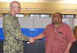 Distribution's Sims presented with commander's coin
