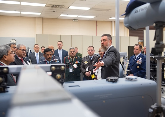 Paul Fleitz, Air Force Research Laboratory Air-Launched Off-Board Operations team lead, shows a visiting Indian military delegation through the ALOBO research facility on Wright-Patterson Air Force Base, Ohio, Jan. 30, 2019. AFRL hosted the delegation in an effort to increase international scientific and technological engagement. (U.S. Air Force photo by R.J. Oriez)