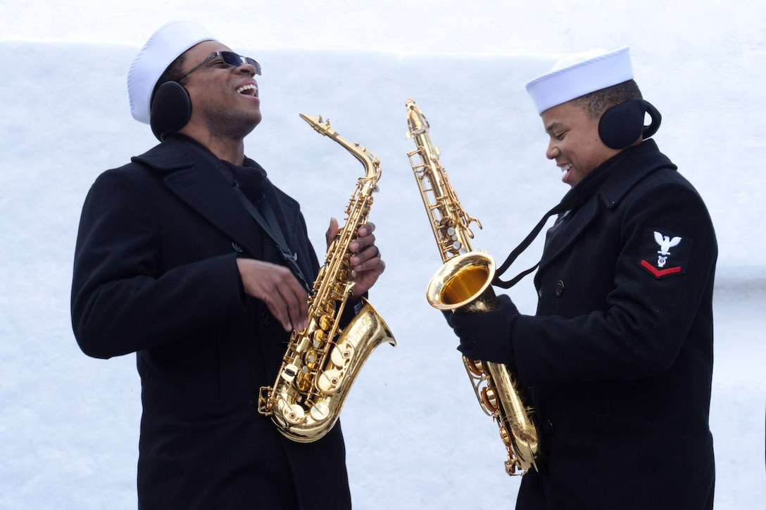 Two sailors playing saxophones.