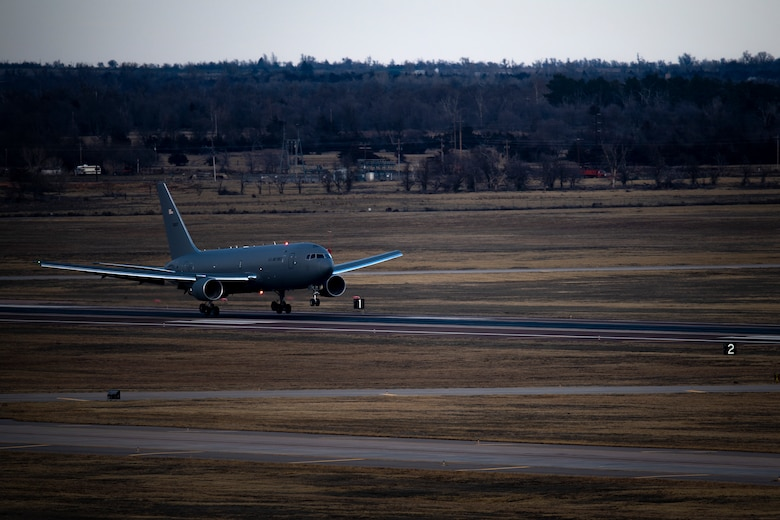 A KC-46 Pegasus lands on a runway of the 97th Air Mobility Wing for the first time Feb. 8, 2019, at Altus Air Force Base, Okla.