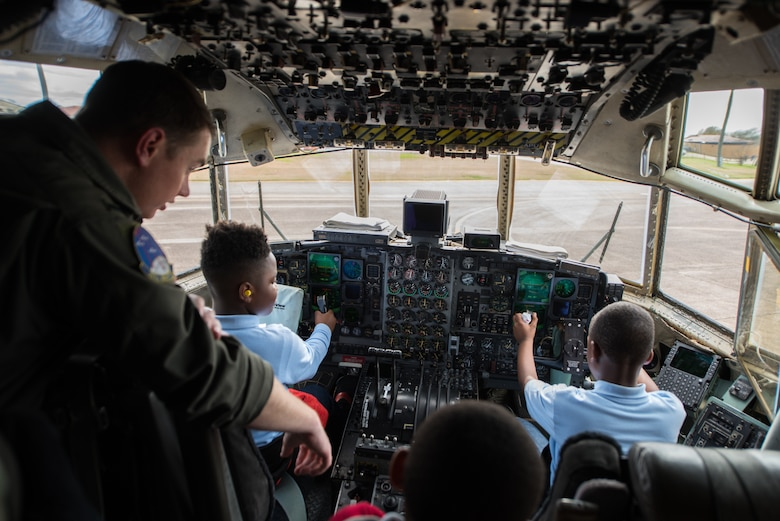 Students from Thelma S. Morris Elementary School find out what it feels like to be in the pilot's seat of a C–130 Hercules during a base visit Feb. 5, 2019, Maxwell Air Force Base, Alabama. The 42nd OSS invited T.S. Elementary School students and their teachers to demonstrate the different mission sets and careers of the Air Force, specifically careers that are STEM related. (U.S. Air Force photo by Senior Airman Alexa Culbert)