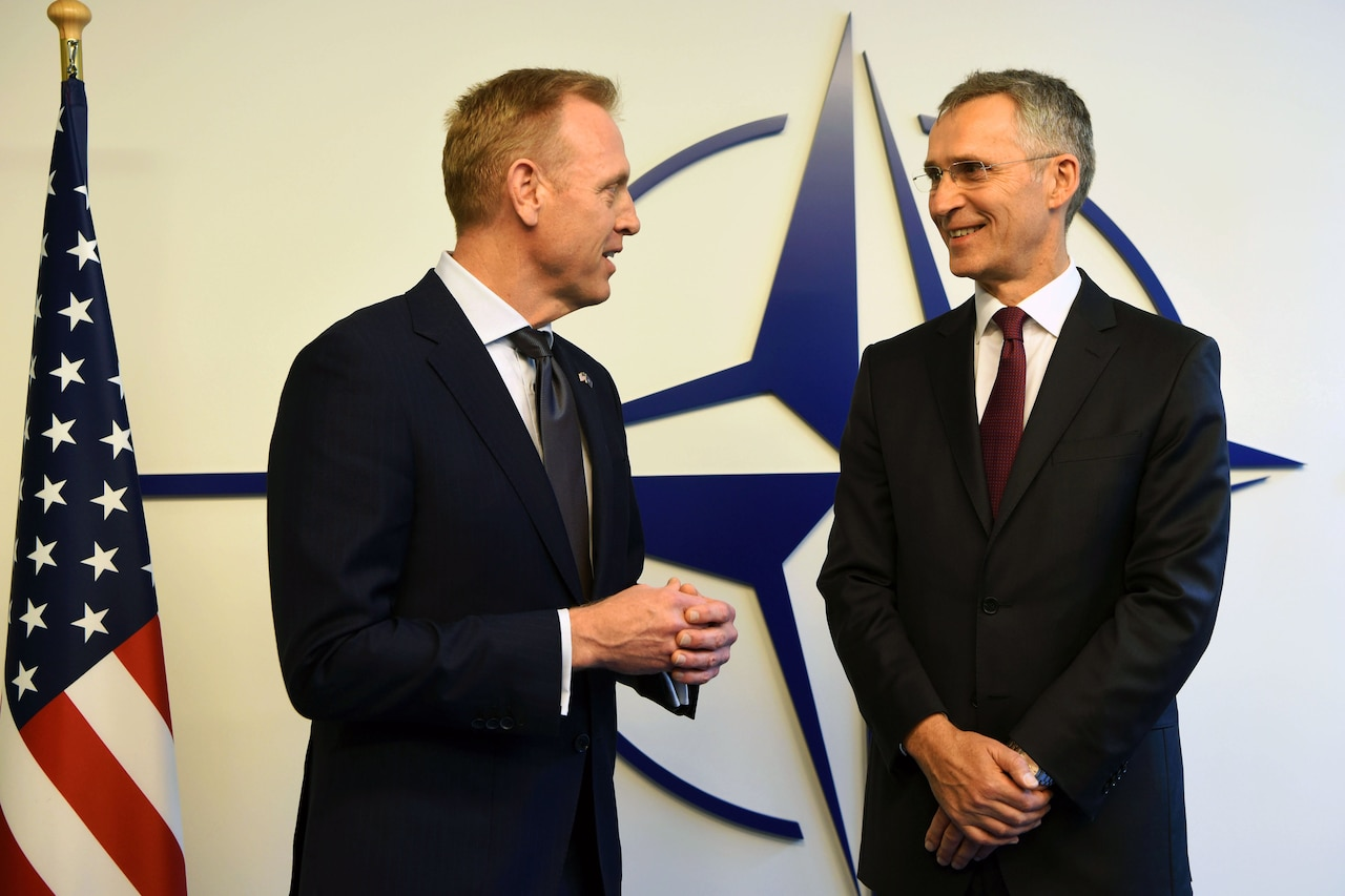 Acting Defense Secretary Patrick M. Shanahan stands next to NATO Secretary General Jens Stoltenberg.