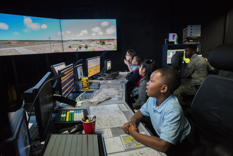 A group of third graders from Thelma S. Morris Elementary School check out the air traffic control simulator during a base visit Feb. 5, 2019, Maxwell Air Force Base, Alabama. The simulator is used to train new air traffic controllers and afterwards the students had an opportunity to climb to the top of the air traffic control tower themselves. (U.S. Air Force photo by Senior Airman Alexa Culbert)