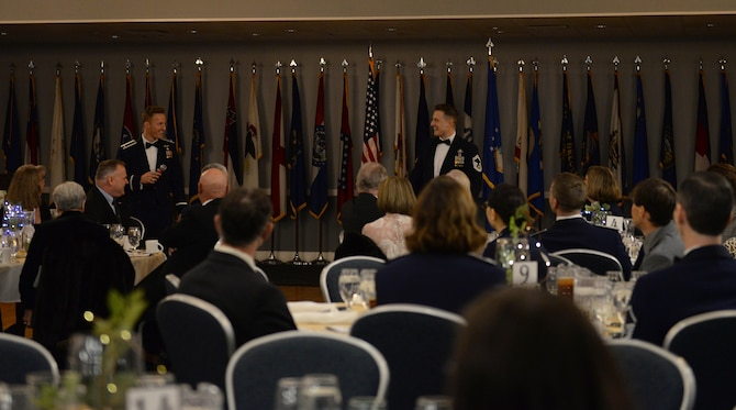 Senior Master Sgt. Garrick, 14th Operations Support Squadron chief controller of air traffic control, and 1st Lt. Dennis Cook, 50th Flying Training Squadron instructor pilot, welcome attendees to the 14th Flying Training Wing's 2018 Annual Awards Banquet Feb. 8, 2019, at the Club on Columbus Air Force Base, Mississippi. Forty-three members and four teams, which represented 16 categories, were recognized and competed for 16 wing-level awards. (U.S. Air Force photo by Airman Hannah Bean)