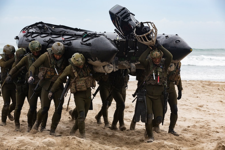 Japan Ground Self-Defense Force (JGSDF) Soldiers move a combat rubber raiding craft inland during Iron Fist 2019, Feb. 1, on U.S. Marine Corps Base Camp Pendleton, CA.