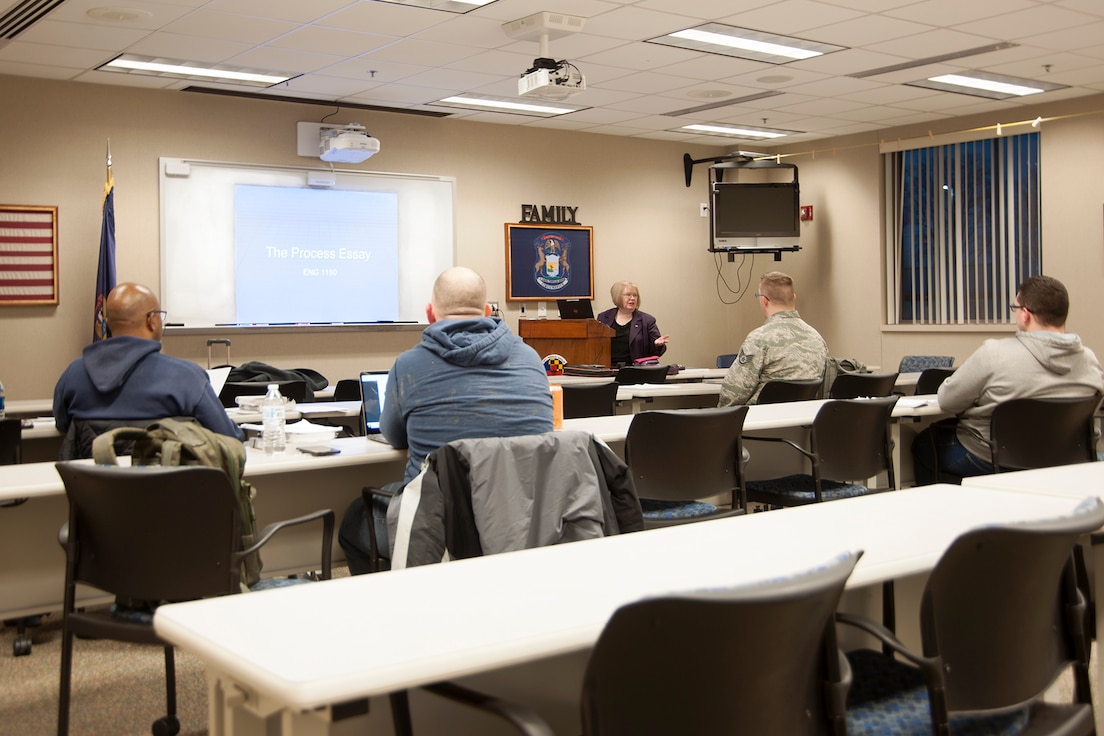 Servicemembers, from multiple units of the 127th Wing, take an evening English course on base on February 5, 2019.