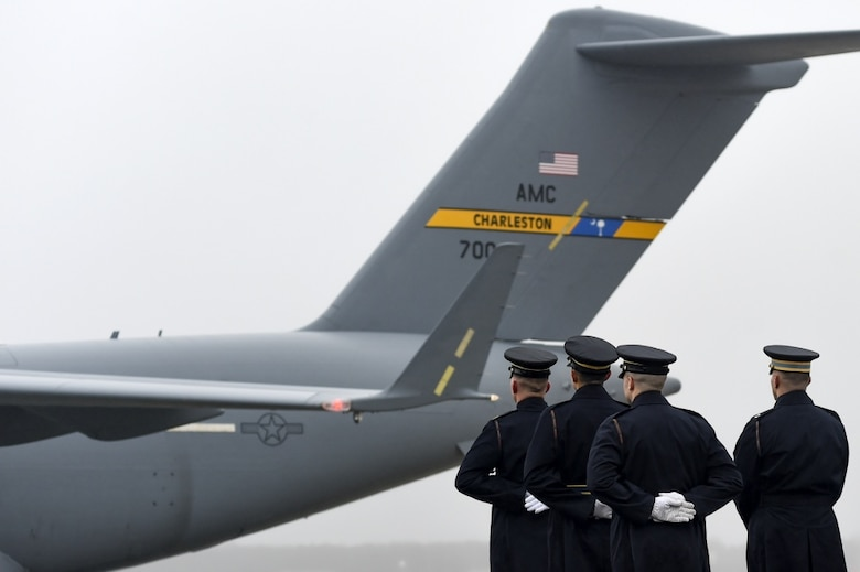 The U.S. Army 3rd Infantry Regiment (The Old Guard) body bearer team falls into formation as an Air Mobility Command C-17 Globemaster III arrives at Joint Base Andrews, Md. with the remains of World War II Army veteran and former Rep. John D. Dingell (D-Mich.) Feb. 12, 2019.