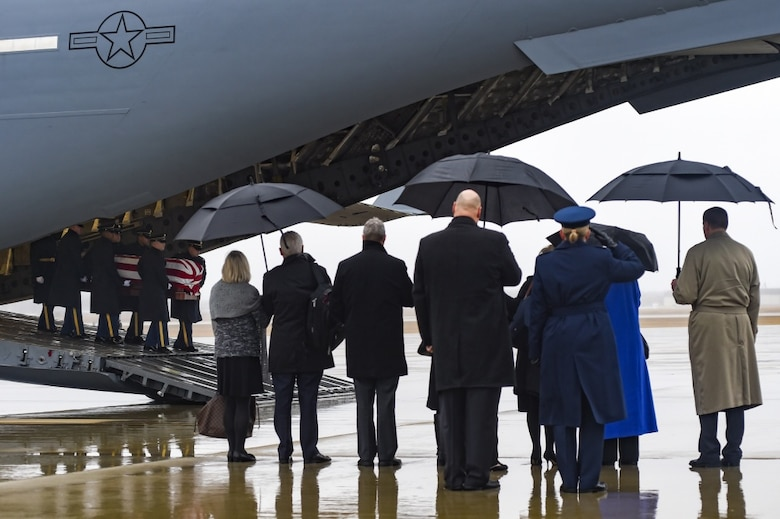 A C-17 Globemaster III assigned to the 315th Airlift Wing, Joint Base Charleston, South Carolina, carrying the casket of former World War II veteran and Congressman John D. Dingell lands on Joint Base Andrews, Md., Feb. 12, 2019.