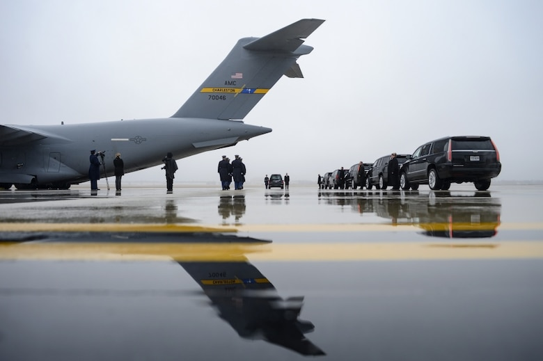The U.S. Army 3rd Infantry Regiment (The Old Guard) body bearer team fall into formation as an Air Mobility Command C-17 Globemaster III arrives at Joint Base Andrews, Md. with the remains of World War II Army veteran and former Rep. John D. Dingell (D-Mich.) Feb. 12, 2019.