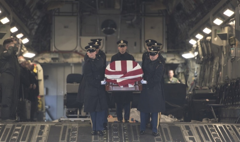 The U.S. Army 3rd Infantry Regiment (The Old Guard) body bearer team carries the casket of former World War II Army veteran and Congressman John D. Dingell at Joint Base Andrews, Md., Feb. 12, 2019.