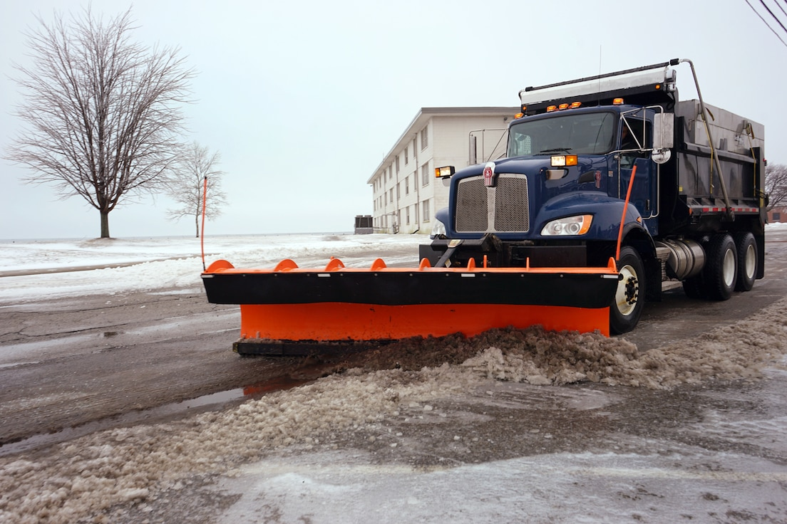 Plow trucks from the 127th Civil Engineering Squadron, Roads and Grounds shop here, diligently clear the ice and snow after an over-night freezing rain and sleet storm at Selfridge Air National Guard Base on Feb. 12, 2019.