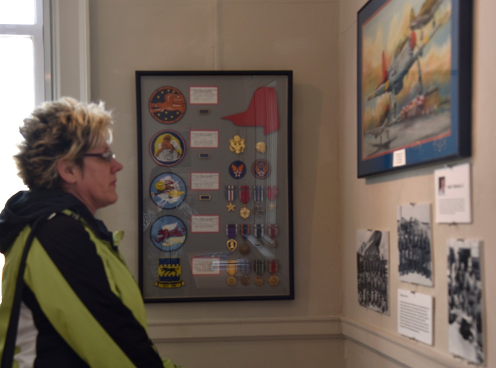 Cean Willis, a Mount Clemens local, is seen viewing some of the Selfridge Air National Guard Base art on display at the Anton Art Center in Downtown Mount Clemens on Feb. 2, 2019.