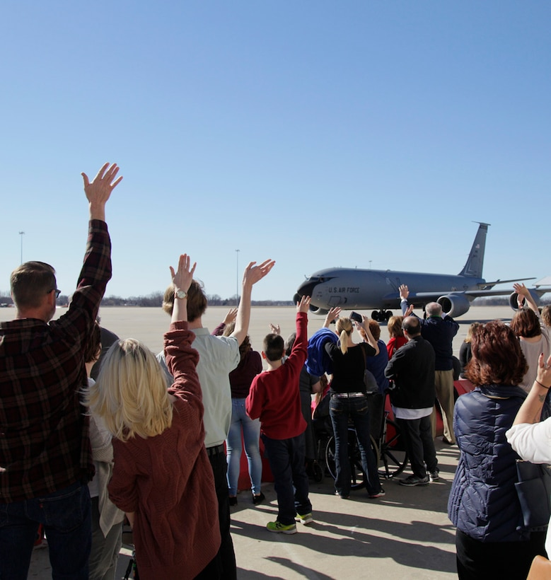 Family members await the arrival of Airmen returning home from a deployment at Selfridge Air National Guard Base, Mich., Feb. 19, 2017.