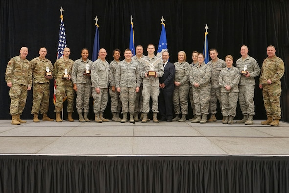 Brig. Gen. John D. Slocum (pictured far left), commander of the 127th Wing, and Chief Danny McDow (pictured far right), command chief master sergeant of the 127th Wing, awarded winners of the Wing's 2018 annual awards program at Selfridge Air National Guard Base, on December 1, 2018.
