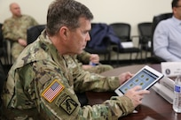 The U.S. Army G1, Lt. Gen. Thomas Seamands, previews the Integrated Personnel and Pay System - Army (IPPS-A) app while visiting Pennsylvania Army National Guard Soldiers at Fort Indiantown Gap Feb. 7.